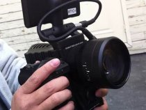 Fixed Lens 8X Zoom Red Scarlet Camera: Working In The Hand: