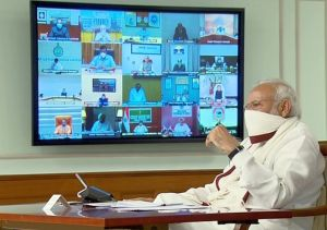 Prime Minister Narendra Modi seen wearing a mask during video-conferencing with the Chief Ministers over COVID19
