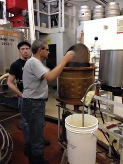 Transfering the wort to a copper kettle to boil. Hops are added for flavour at this time.