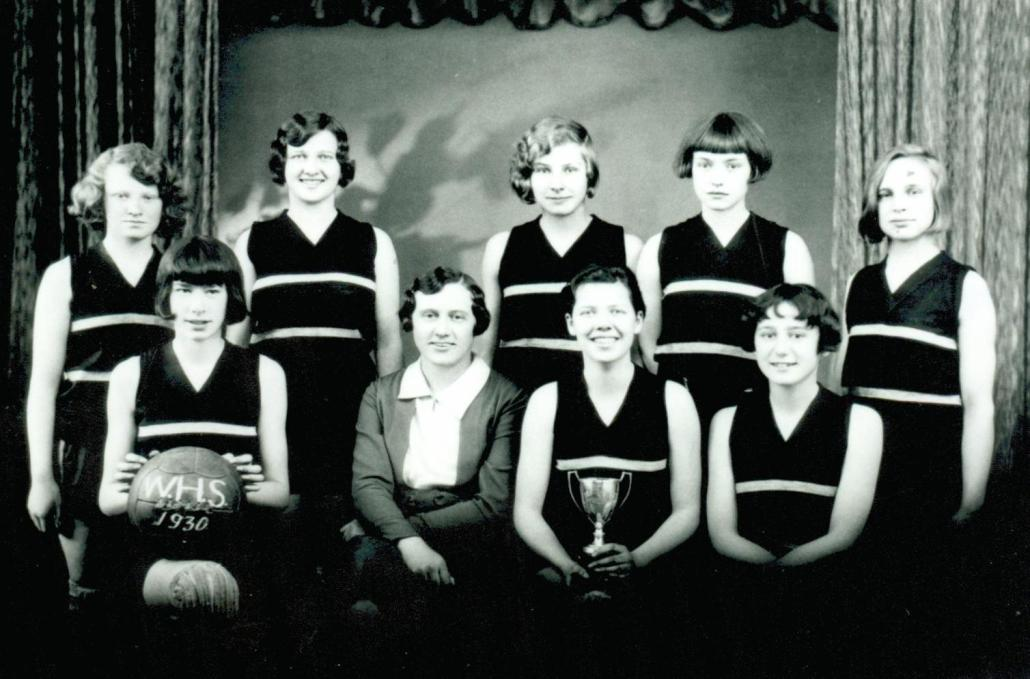 Champion Junior League High School basketball champions, 1929-30. B. Clarke, K. Hay, J. Cameron, M. Gayler, M. Goldsworthy, N. McDonald, Miss Ewing (coach), N. Hay and E. Ramsay. Edmonton Public Schools Archives, P85.2.9.