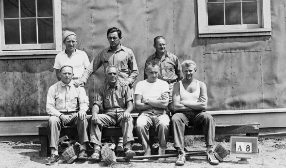 Prisoners at Ripples Internment Camp 70 circa 1941. The camp was located about 20 miles from Fredericton, New Brunswick. Antonio Rebaudengo from Calgary, Alberta is second in the front row and was arrested on June 10, 1940 and was not released until September 25, 1943. He was initially interned at the Kananaskis Camp and, then, at Camp Petawawa, Ontario and, finally, at Ripples. He served the longest of the five Alberta internees.