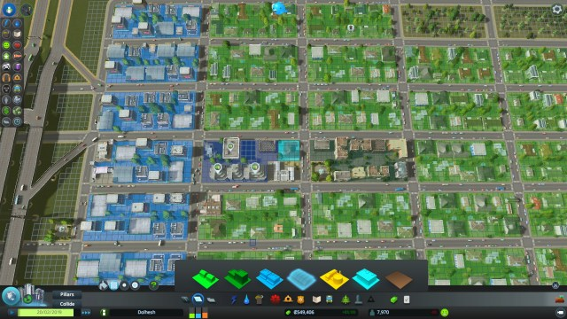 Zoning in Cities: Skylines: low-density commercial (light blue), high-density commercial (dark blue), and low-density residential (green).
