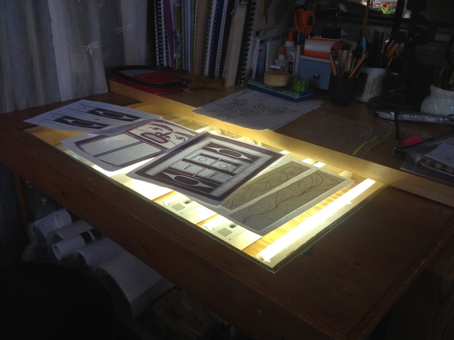 Patterns are being tweaked on Clarissa's old-fashioned light table before they are copied on her Epson printer