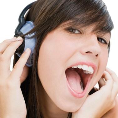Girl wearing headphones and singing