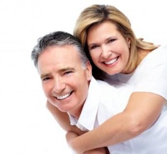 Happy senior couple. Isolated on white background.
