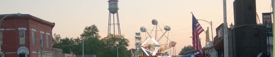 Downtown Lathrop during Friendship Festival with view of historic water tower and carnival rides