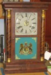 Waterbury Half Column Clock with Coat of Arms Glass Painting
