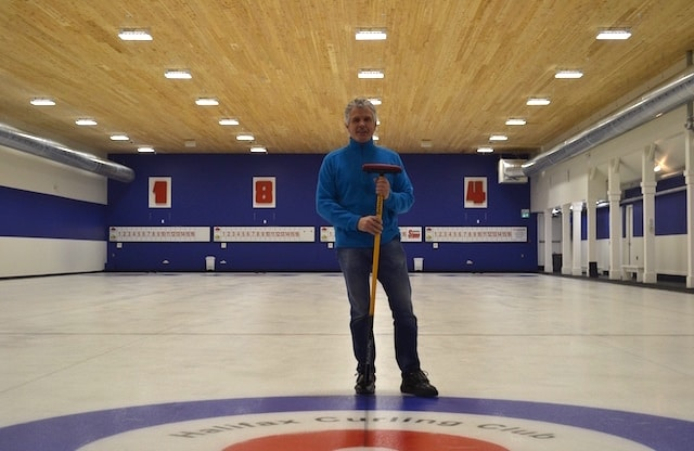 Halifax Curling Club president Grahame Usher stands on the ice of the newly refurbished club (Photo by Jordan Whitehouse)