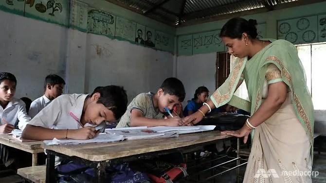 Bangladeshi migrant worker Joy Sudip Bhadro's wife, Ripa Datta, teaching in class.
