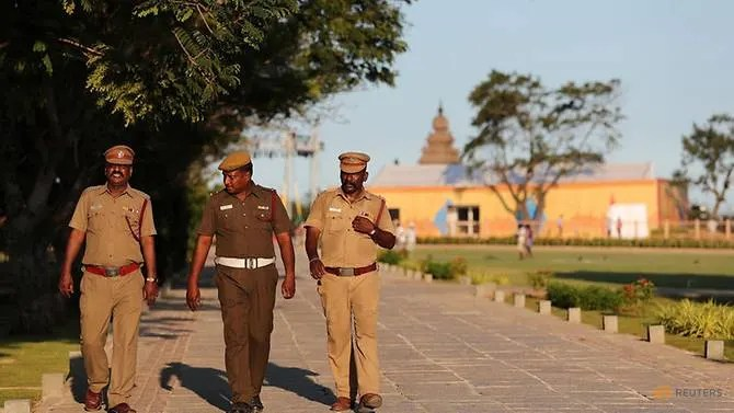 Policemen patrol inside the premises of Shore temple a day before the visit of Chinese President Xi