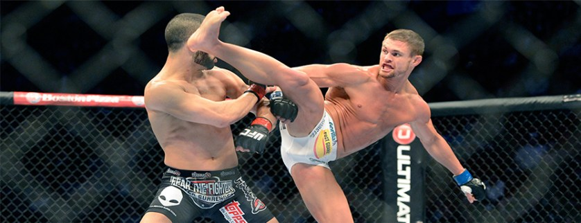 Mar 16, 2013; Montreal, Quebec, CAN; Daron Cruickshank (blue gloves) lands a kick on John Makdessi (red gloves) during their preliminary round bout at UFC 158 at the Bell Centre. Mandatory Credit: Eric Bolte-USA TODAY Sports