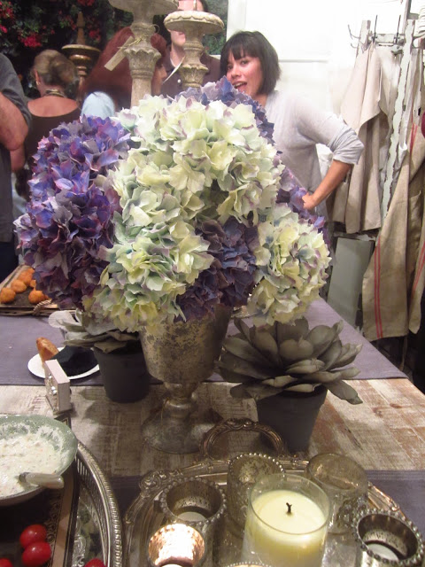 hydrangea flower arrangement on a wood table at the pom pom university party