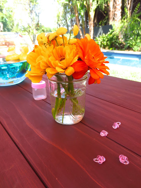 Floral centerpiece at an outdoor baby shower