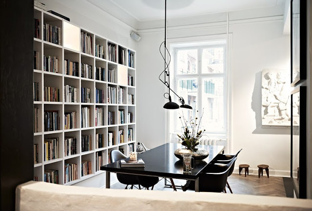 Naja Munthe's dinning room with a wall sized book case