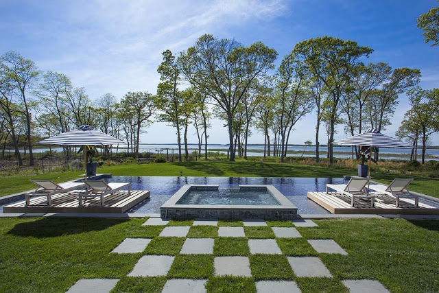 Infinity pool floating decks backyard Sag Harbor home