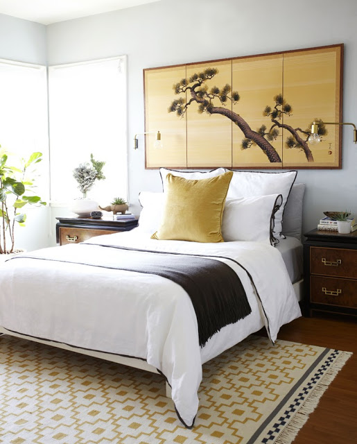 Elegant bedroom gold Chinoiserie screen white bedding brown trim
