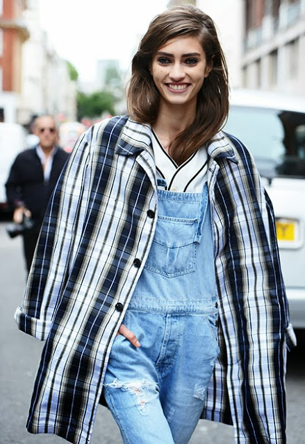 Woman wearing a Tartan plaid coat and denim overalls