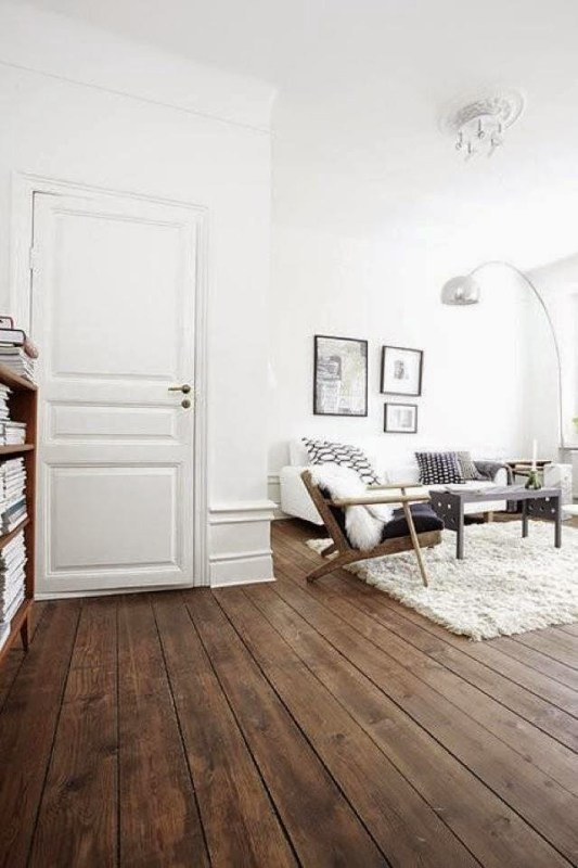 White living room with rustic wood floor