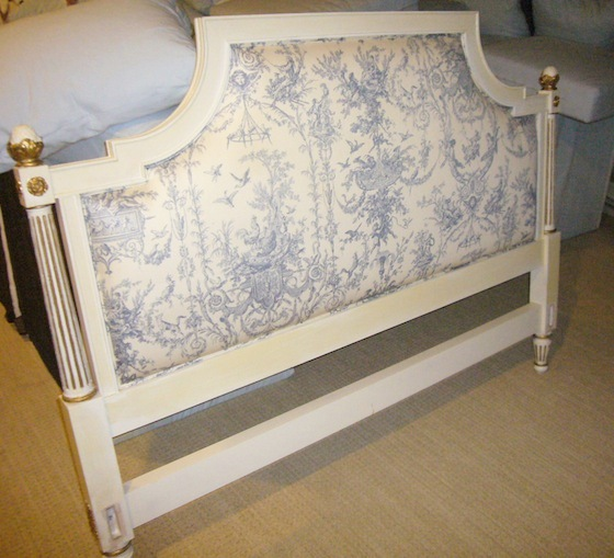 Before makeover: a toile headboard with gold edges
