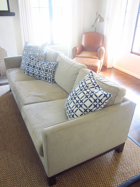 COCOCOZY pillows on a neutral couch in a living room