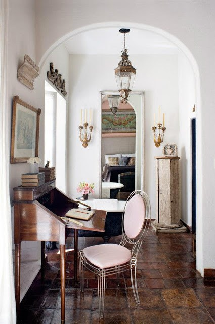 Casamidy's home office with an open writing desk, metal opera chair, brown tiles and white walls