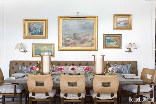 gorgeous dining room with leather sofa, accent lights and paintings by Peter Dunham