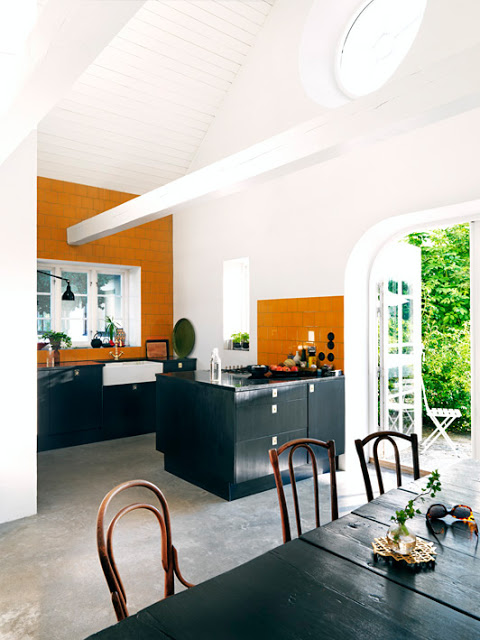 open kitchen dining area orange black small kitchen french doors high ceilings