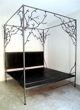 Cassamidy metal canopy bed with plant detailing