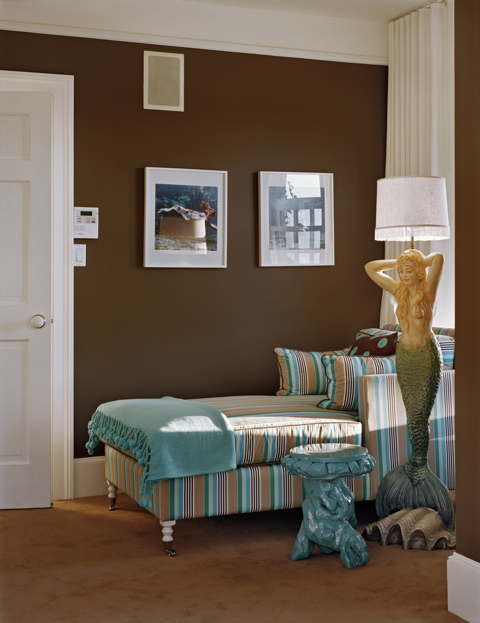 Brown and turquoise bedroom by Ghislaine Vinas with a striped chaise lounge chair and a mermaid lamp