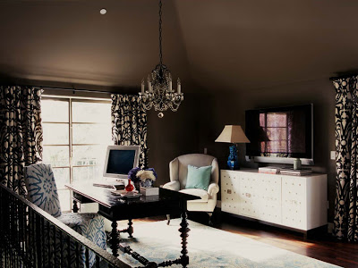 Brown and white home office with brown walls, a crystal chandelier, white lacquer storage cabinet and brown and white brocade curtains