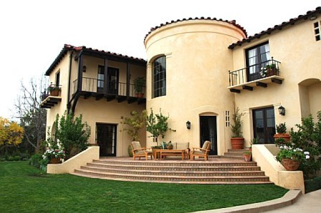 Front entry gets turned into a back patio after remodeling with a view of a lush backyard