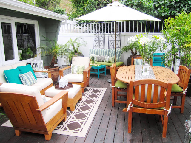 Green, brown and off white deck compliments the hillside setting