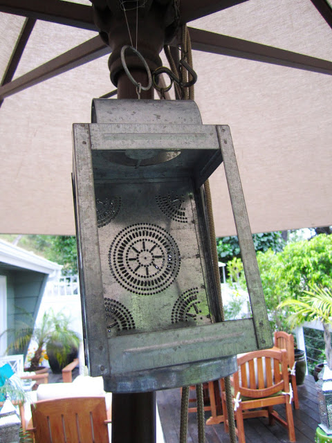 Metal lantern hanging under umbrella