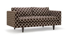 Sofa with tapered legs upholstered in cream and brown trellis pattern fabric from Pal + Smith
