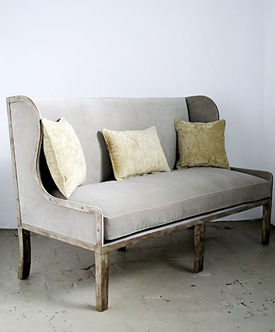 Sofa with a flat iron base upholstered in grey fabric