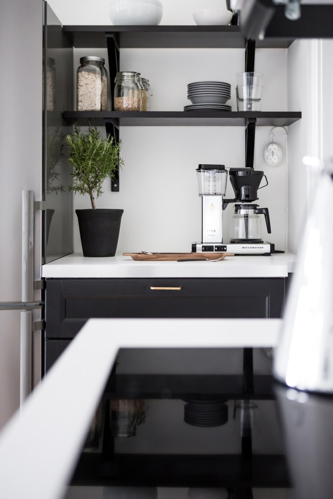 White home with a dark kitchen - via Coco Lapine Design blog