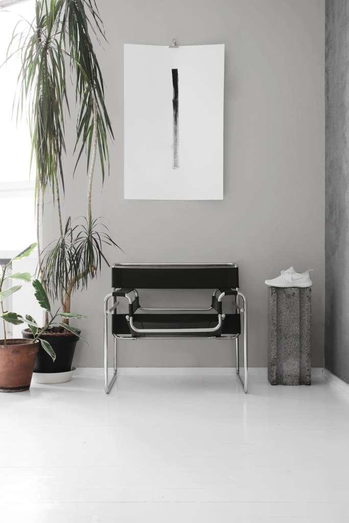 Light bedroom with a concrete wall - via Coco Lapine Design blog