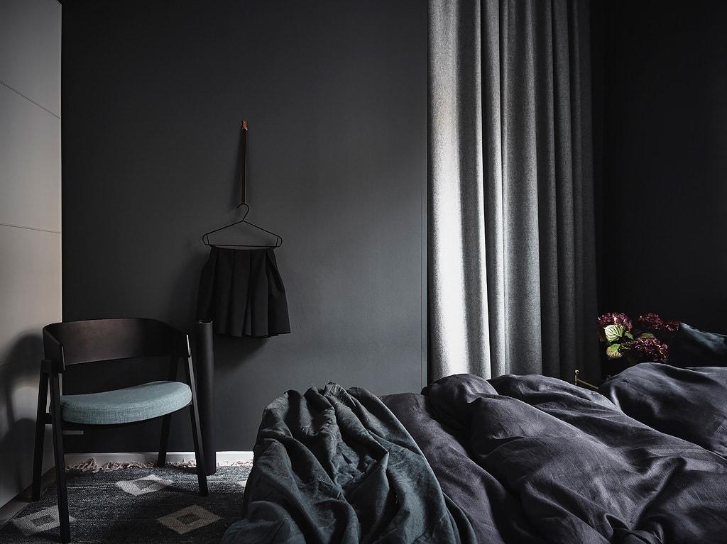 Exposed brick and black bedroom walls - via Coco Lapine Design blog