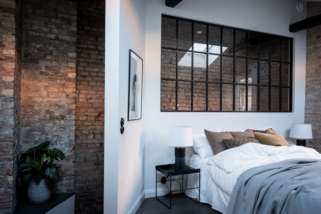 Bedroom with exposed brick - via Coco Lapine Design blog