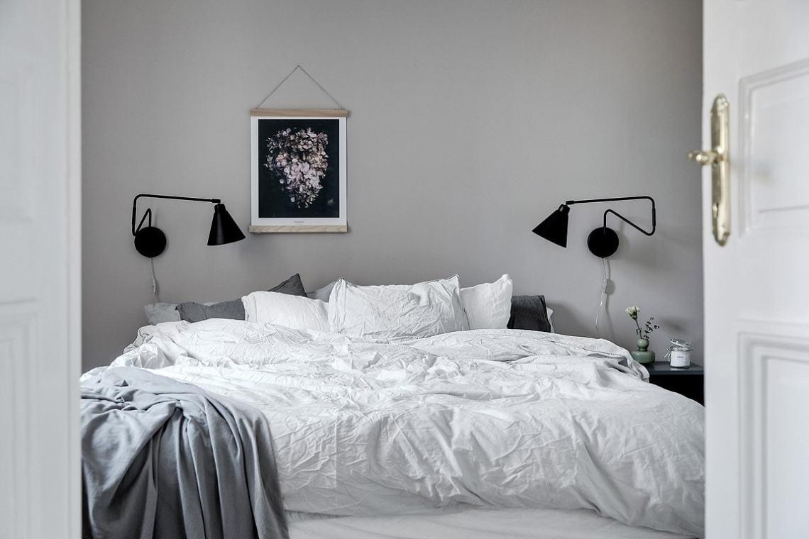 Cozy bedroom behind wing doors - via Coco Lapine Design blog