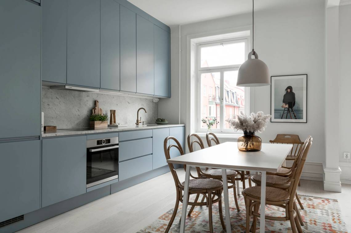 Spacious light blue kitchen