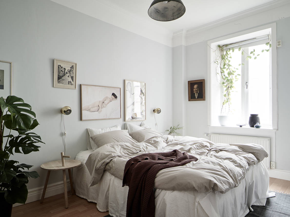 Cozy bedroom with light blue walls