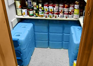 A store of 3.5 gallon 'brick' water containers.
