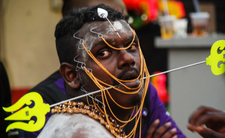 Speared participant of Thaipusam in Penang begins his journey