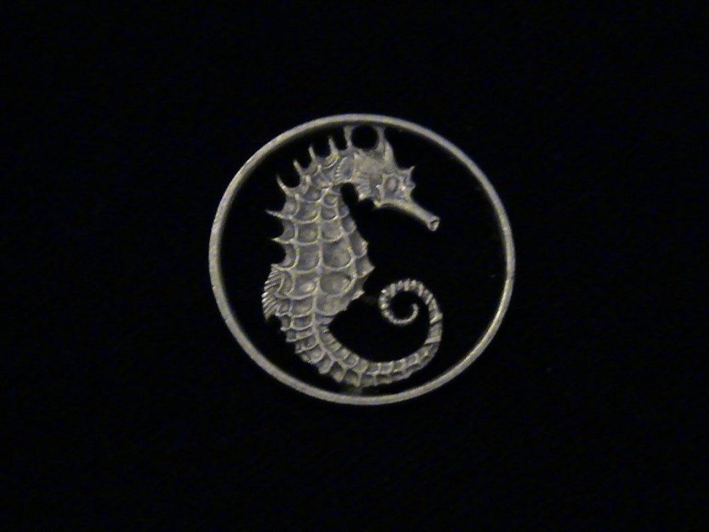 Pendant made using a cutout 1979 Singapore coin