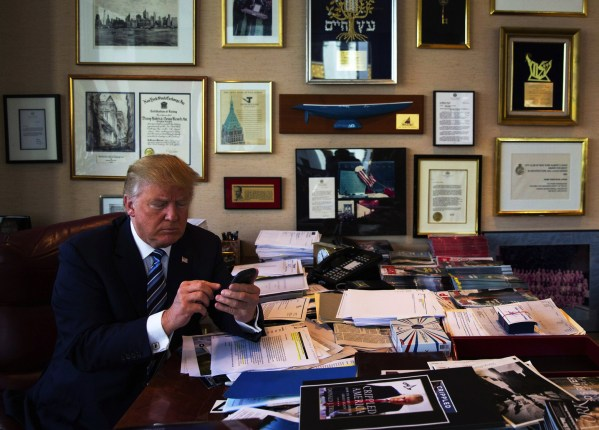 Donald Trump demonstrates his tweeting skills in his office at Trump Tower in New York, Sept. 29, 2015. Some say it took Trump's unfiltered, type-anything style to fulfill what digital strategists have long predicted: a campaign built on social media. (Josh Haner/The New York Times)