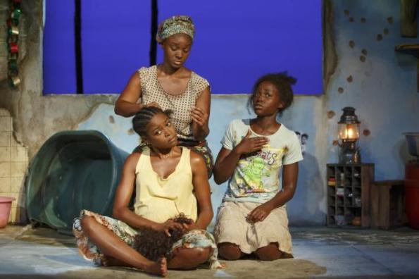 NY Daily News Pascale Armand, Saycon Sengbloh, and Lupita Nyong'o in their compound hut_ Set and costumes by Clint Ramos