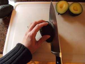 cutting an avocado for homemade guacamole