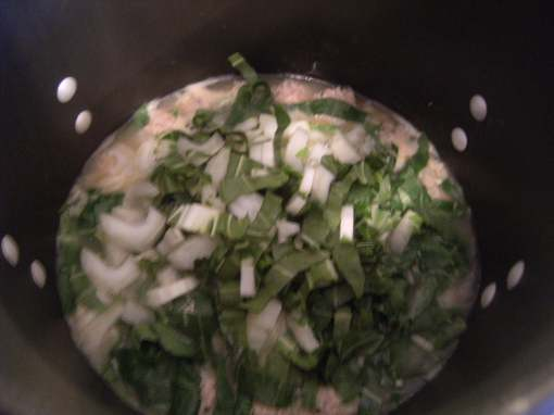 adding veggies to turkey meatball soup