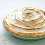 The-Best-Lemon-Meringue-Pie features exceptionally tangy lemon custard filling topped with toasted sweet meringue, cradled in a golden, buttery crust.
